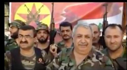 Türkisch-alawitischer Milizchef Mihrac Ural mit Gefolgsleuten